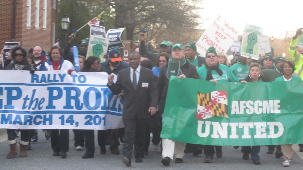 Alvin Thornton (in suit) and union leaders head march to State House.