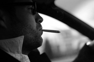 Smoking in a car. by Wout de Jong