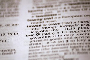 tax definition in dictionary