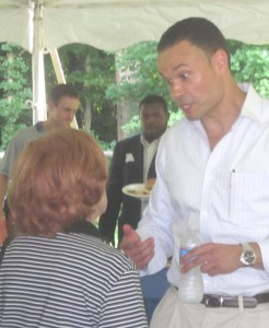 Dan Bongino talks to woman at Sunday picnic.