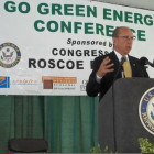 Bud Otis at podium with Rep. Roscoe Bartlett, left, at 2010 energy conference.