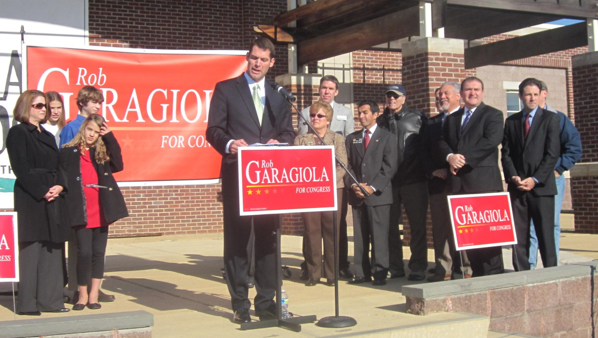 Sen. Rob Garagiola announces for Congress, with his family to the left and elected officials to the right.