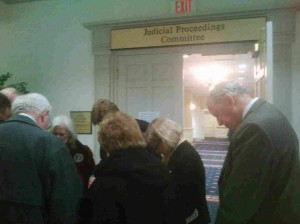 Supporters of traditional marriage pray outside the Senate Judicial Proceedings hearing room.
