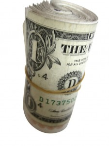 Roll of dollar bills by Images of Money