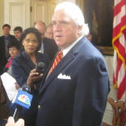 Senate President Mike Miller talks to reporters after bill signing.