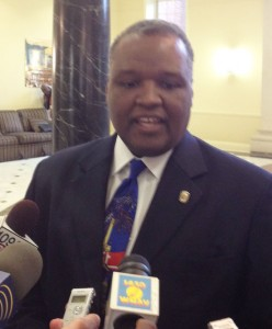 Rushern Baker speaks to reporters