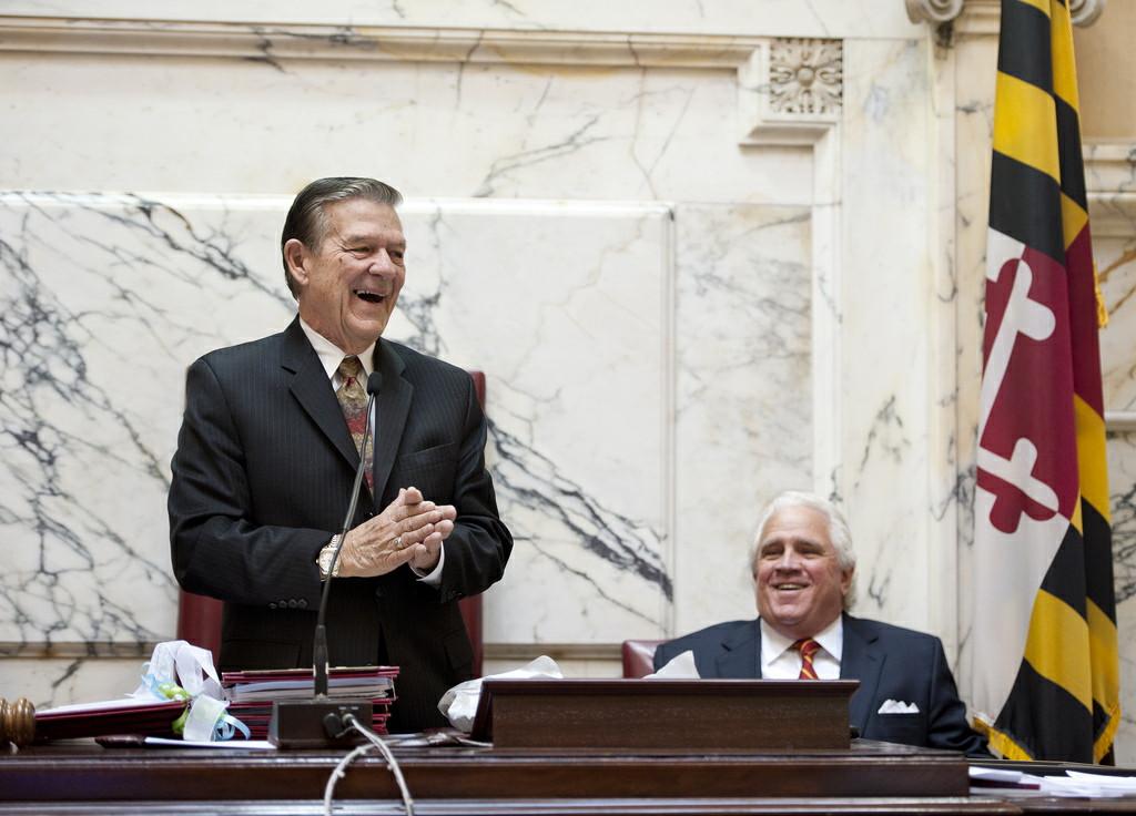 Sen. Norman Stone, left, at Senate rostrum with Senate President Mike Miller.
