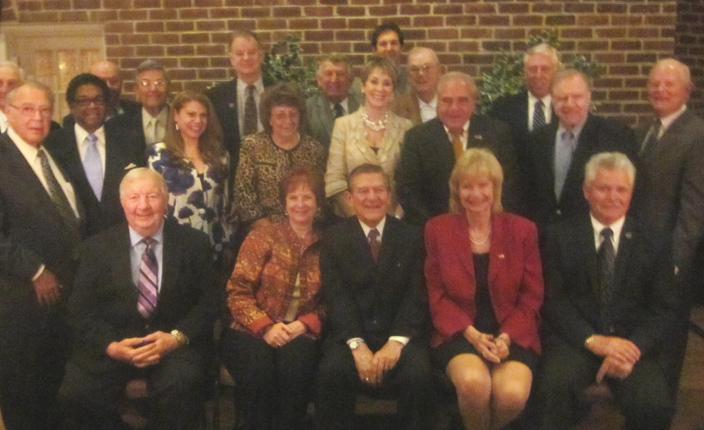 Sen. Norman Stone, seated at center, with current and former legislators Tuesday night.