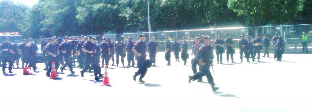 Police double time across street near stadium in Charlotte.