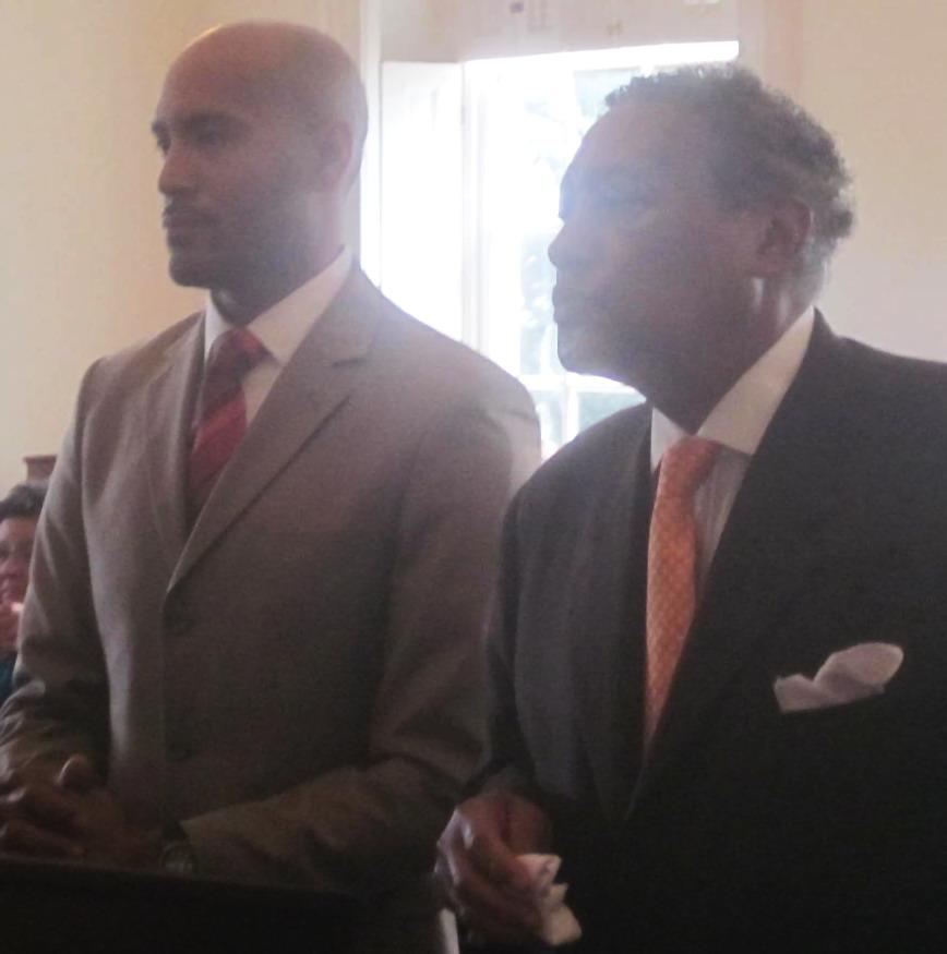 Transit Administrator Ralign Wells, left,  and Arnold Jolivet of the Minority Contractors Association.