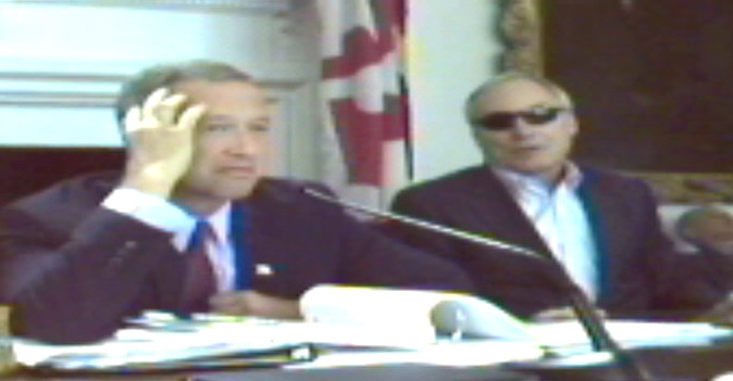 Comptroller Peter Franchot, right, donned sunglasses after laser eye surgery at the Board of Public Works with Gov. Martin O'Malley. (From streaming video)