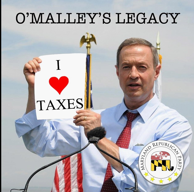 "A fictional photo of Gov. Martin O'Malley holding up a sign saying ""I love taxes."""