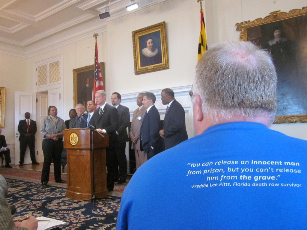 Kirk Bloodsworth, foreground, listens as Gov. Martin O'Malley talks about death penalty repeal.