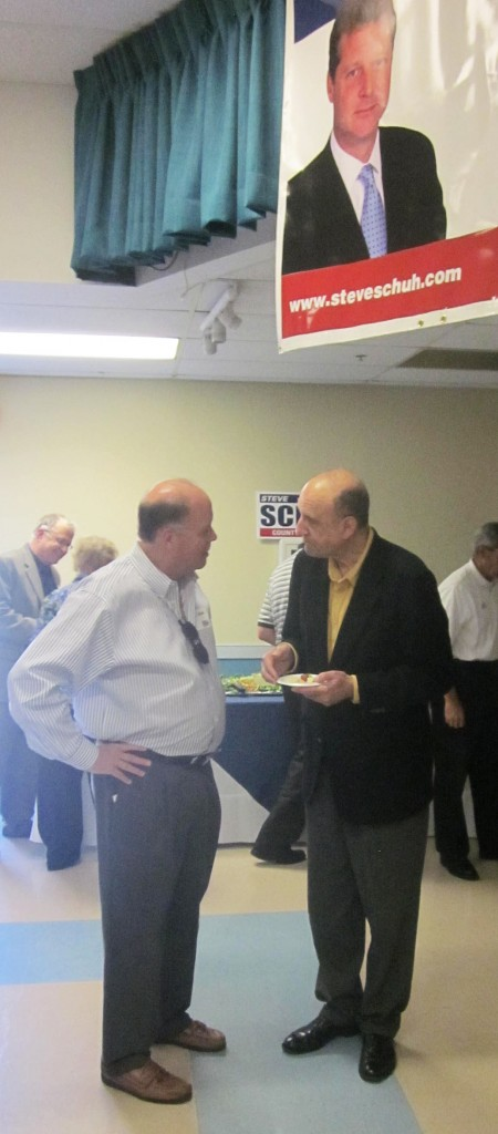 Former Anne Arundel County Executive John Leopold, right, talks with guest at Del. Steve Schuh's announcement.