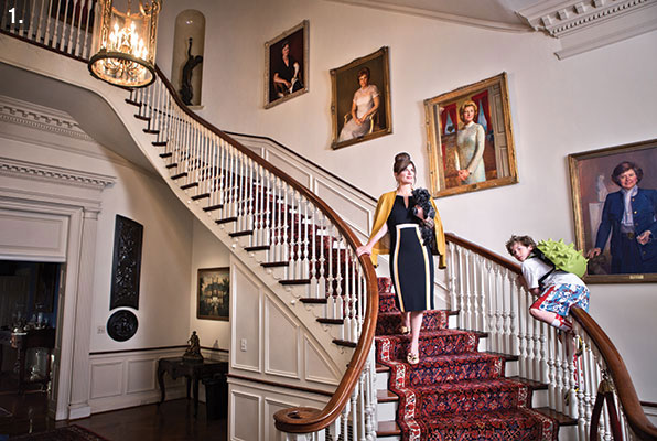 Katie O'Malley on the grand staircase of Government House, with son Jack on the bannister.