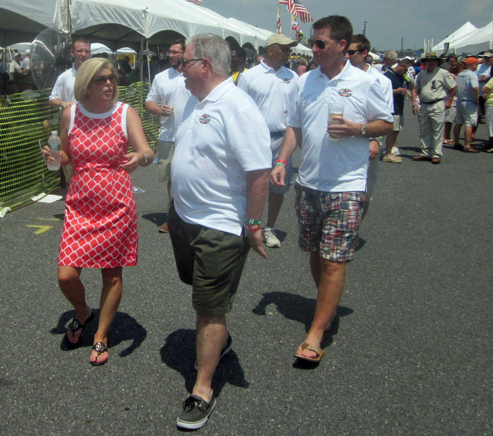 Anne Arundel County Executive Laura Neuman walks with businessman Larry Hogan and his Change Maryland entourage.