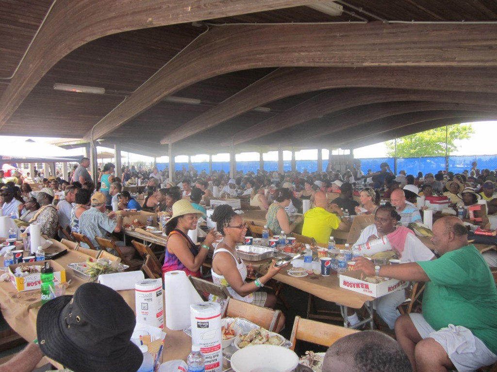 Thousands of regular people eat crabs, clams and corn in the main hall of the Somers Cove Marina.