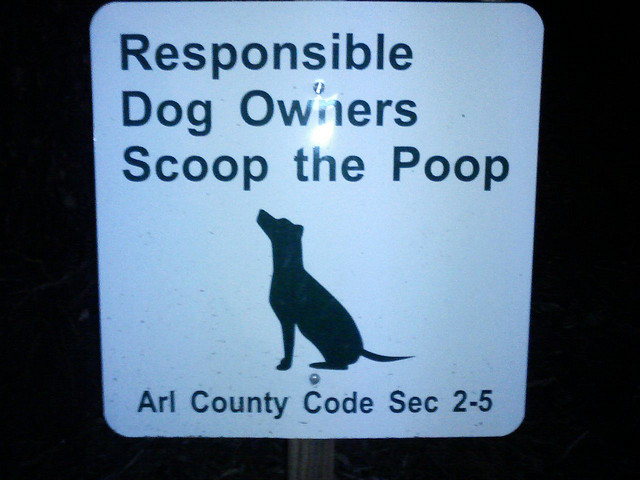 Sign: Responsible Dog owners scoop the poop (By voteprime on Flickr)