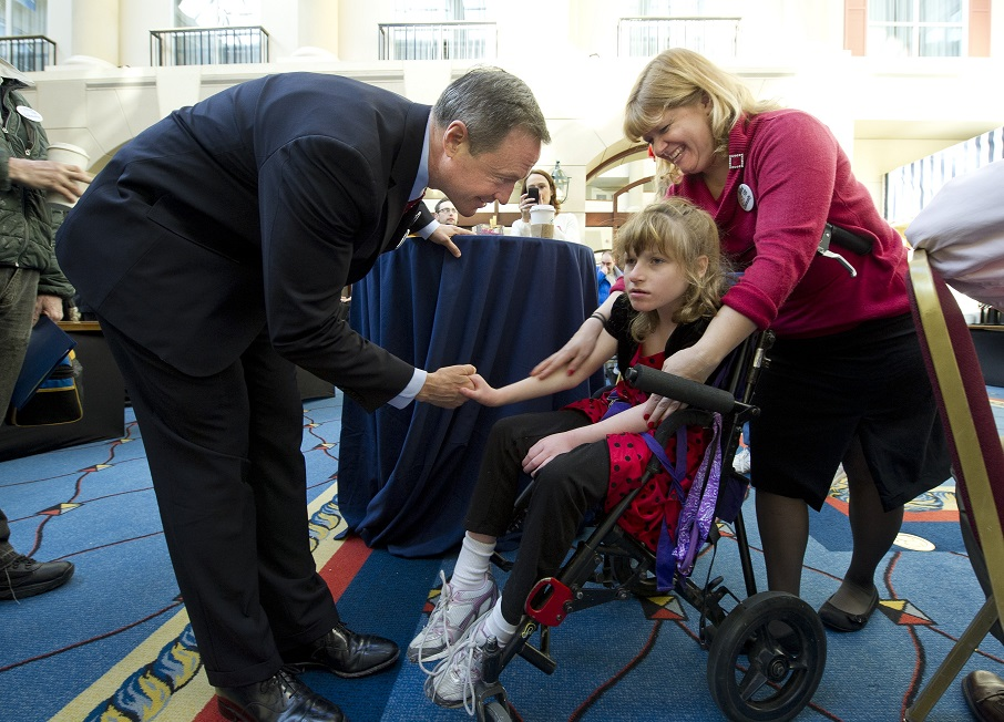 Gov. Martin O'Malley greets girl in wheelchair at Maryland Developmental Disabilties Coalition meeting her addressed last year. Photo by MdGovPics on Flickr