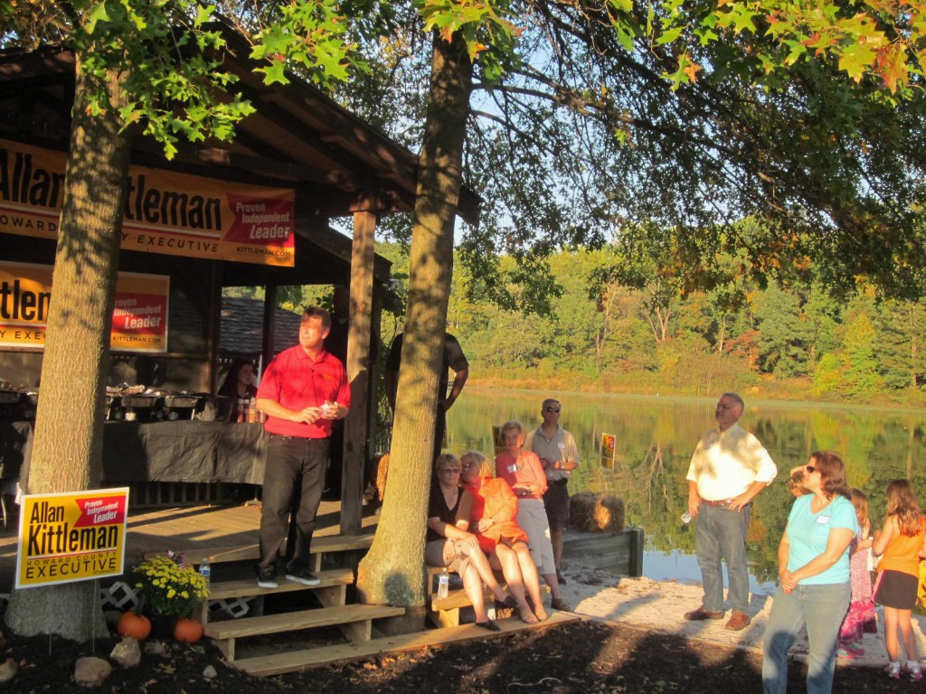 Sen. Allan Kittleman in red shirt addresses crowd at his picnic Sunday.