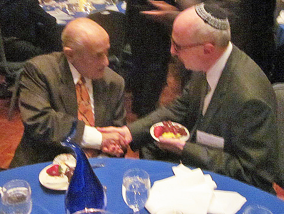 Former Gov. Marvin Mandel, left, is congratulated by Rabbi Stuart Weinblatt of Congregation B'Nai Tzedek in Potomac.