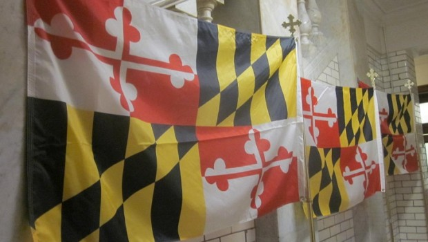 In a ground floor hallway of the State House, Maryland flags are readied for governor's State of the State address.