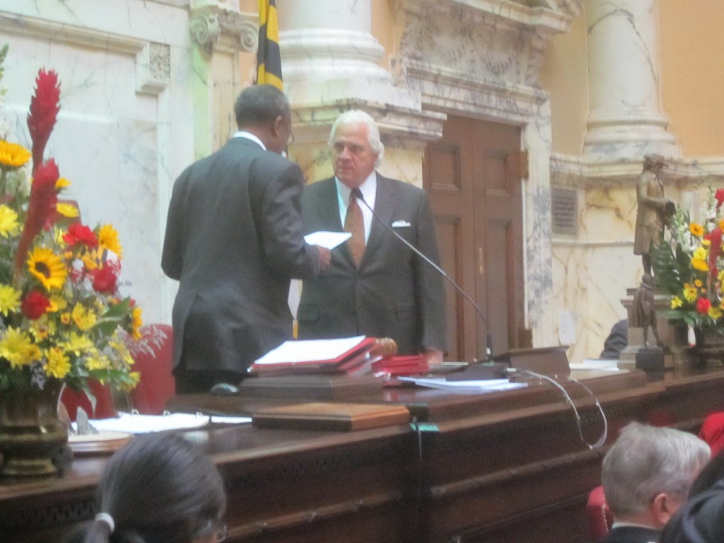 Senate President Protem Nathaniel McFadden, left, swears in Senate President Mike Miller on Wednesday.