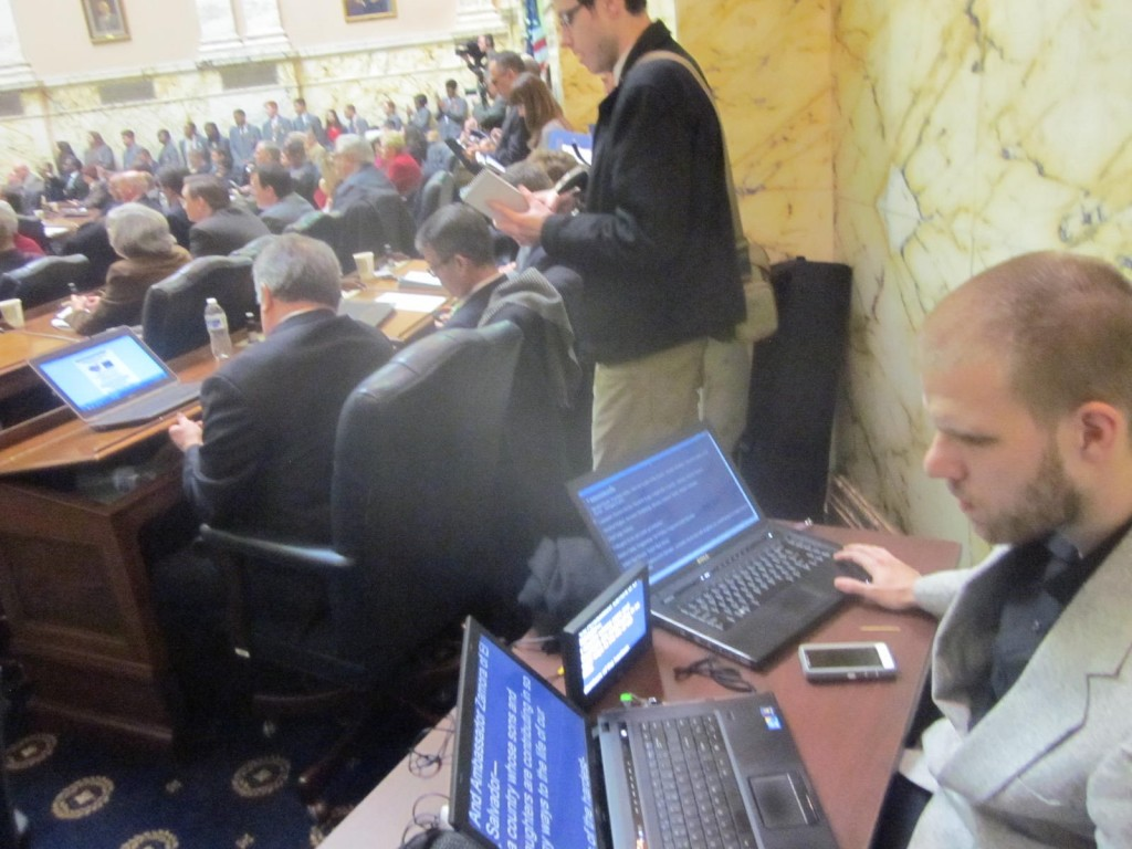 The telepompter operator in the back corner with reporters along the back wall. (MarylandReporter.com)