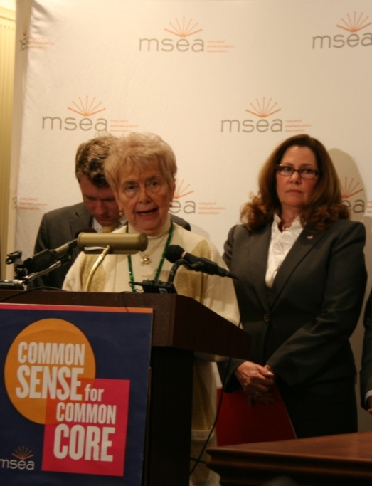 Ways & Means Chair Sheila Hixson at podium, with Del. Eric Luedtke and MSEA President Betty Weller