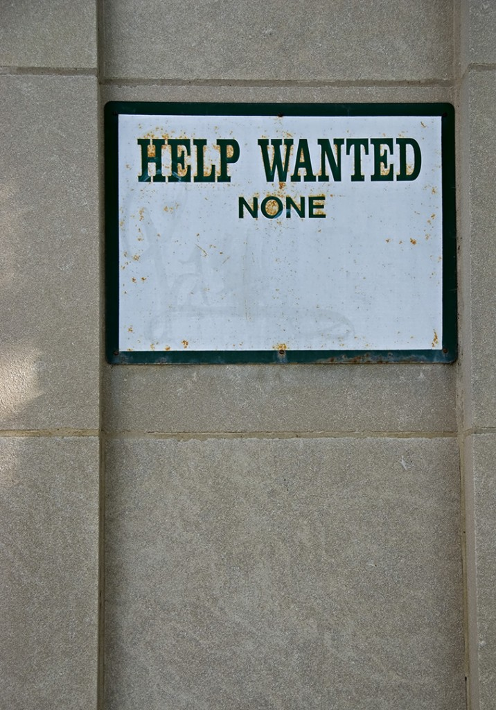 Sign says: Help wanted None.