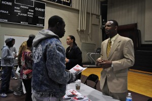 Robert Wheeler, right, with ex-offender at job fair in gym of St. Francis Academy,