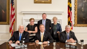 Gov. Martin O'Malley signs the Budget Reconciliation and Financing Act last Friday, with Senate President Mike Miller, left, and House Speaker Michael Busch, right; behind them Sen. Nancy King, left, and Del. Sheila Hixson, right.