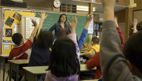 Classroom teacher raised hands school (By www.audio-luci.it on Flickr)