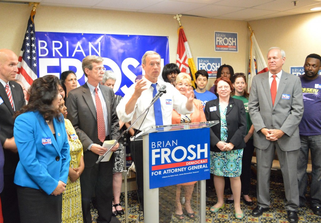 Gov. Martin O'Malley at podium endorses Sen. Brian Frosh, left of governor, for attorney general, on surrounded by legislators from Montgomery and Prince George's counties and union members.