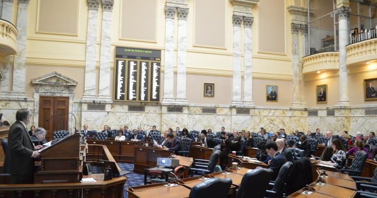 Warren Deschenaux at podium briefs newly elected legislators in December.