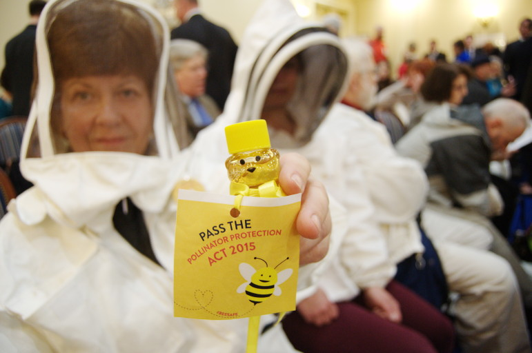 Sondra Novo, a beekeeper from Harford County, holds a honey-filled bear which she and other beekeepers delivered to legislators' offices. (By Rebecca Lessner for MarylandReporter.com)
