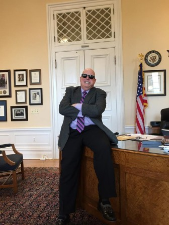 "From Larry Hogan's Facebook page: ""Had a productive day in the office today! During my interview with the Washington Post, the photographer asked me to do a full Kojak look - tootsie roll pop and all! ""Who loves 'ya, baby?"""