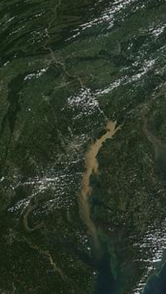 This satellite photo shows a plume of sil from 19 million tons of nutrient laden sediment spilled into the upper bay from Tropical Storm Lee, September 2011, four million tons was scoured from behind the Connowingo dam