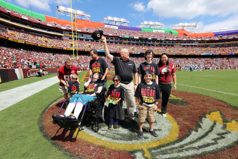 HAIL TO THE SKINHEADS: Gov. Larry Hogan, who grew up in Prince George's County, makes no secret of his support for the Washington football team that plays it home games there. On Sunday, as he battles cancer, he appeared in the end zone with four children from the Cool Kids Campaign, who are also battling cancer to recognize September as Childhood Cancer Awareness Month.  The Cool Kids Campaign is a non-profit organization devoted to improving the quality of life for children with cancer and their families. Photo by Governor's Office.