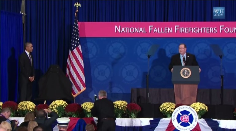 President Obama prepares to unveil plaque of fallen firefighters. From White House video.
