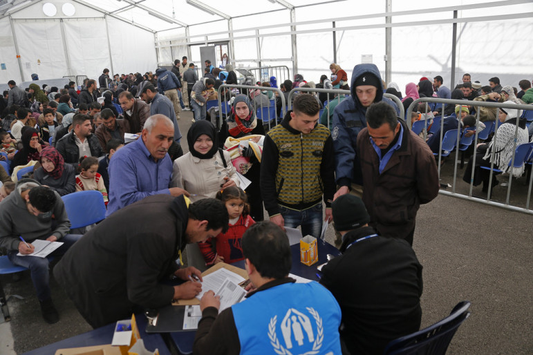 A family submitting an application at the U.N. High Commission for Refugees registration center in Tripoli-Lebanon in 2014. By Mohamed Azakir, World Bank Photo-Collection with Flickr Creative Commons License.