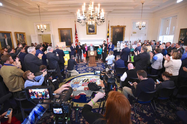 The Governor's Reception Room was packed with staff and cabinet secretaries clapping, shouting and whistling as Gov. Hogan announced he was cancer free. Print scribes are seated, likely tweeting the news on their smart phones.