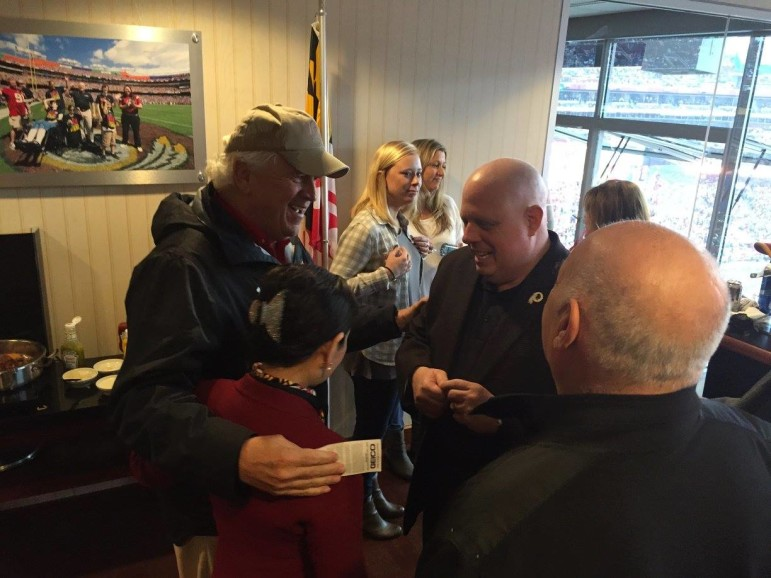 Not only is Hogan riding high, so is the Washington football team, which the governor watched beat the Giants from the state box at FedEx field. Senate President Mike Miller (in hat) visited Hogan and First Lady Yumi Hogan.