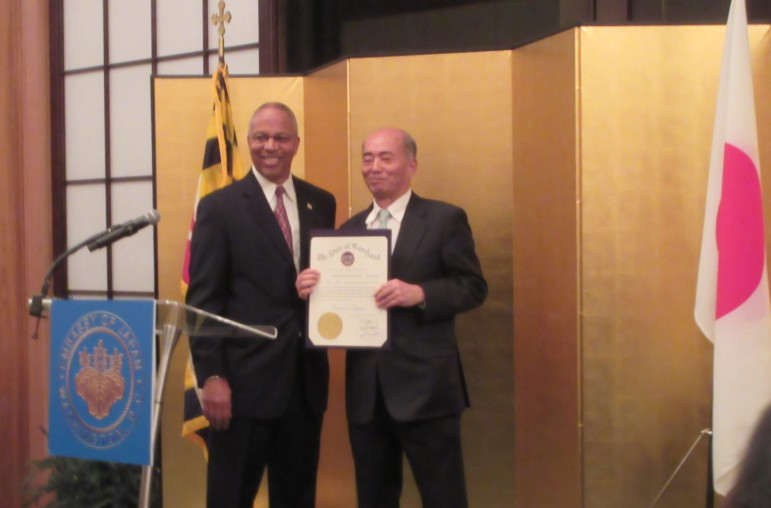 Lt. Gov. Boyd Rutherford presents a governor's citation to Japanese Ambassador Kenichiro Sasae at the envoy's residence Monday night.