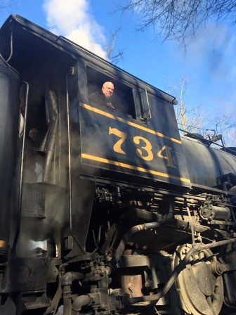 Gov. Larry Hogan in the engineer's seat of the Western Maryland Scenic Railroad, part of a four-day trip to Western Maryland.