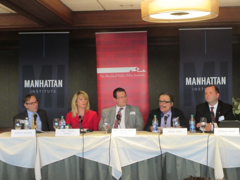 The conference panel, from left: Howard Husock of the Manhattan Institute; Labor Secretary Kelly ?Schulz; Chris Shank, director of the Governor's Office of Crime Control and Prevention; Peter Cove of America Works; and Public Safety Secretary Stephen Moyer.