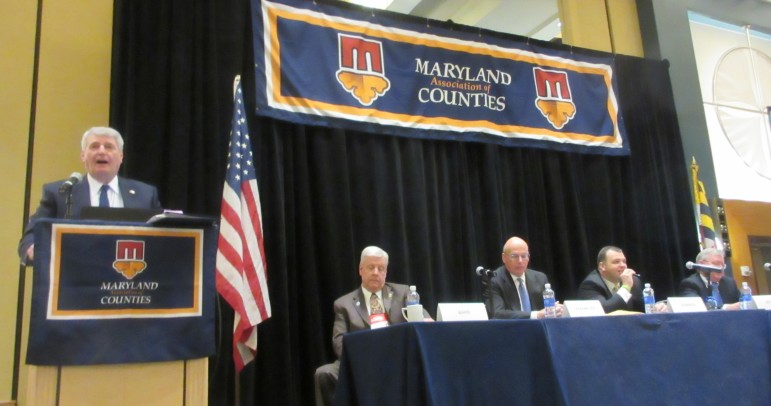 House Speaker Michael Busch addresses Maryland county officials on a panel moderated by new MACo President John Barr, a Washington County commissioner, Sen. Ed Kasemeyer, Sen. J.B. Jennings, and Joe Getty, the governor's chief legislative officer.