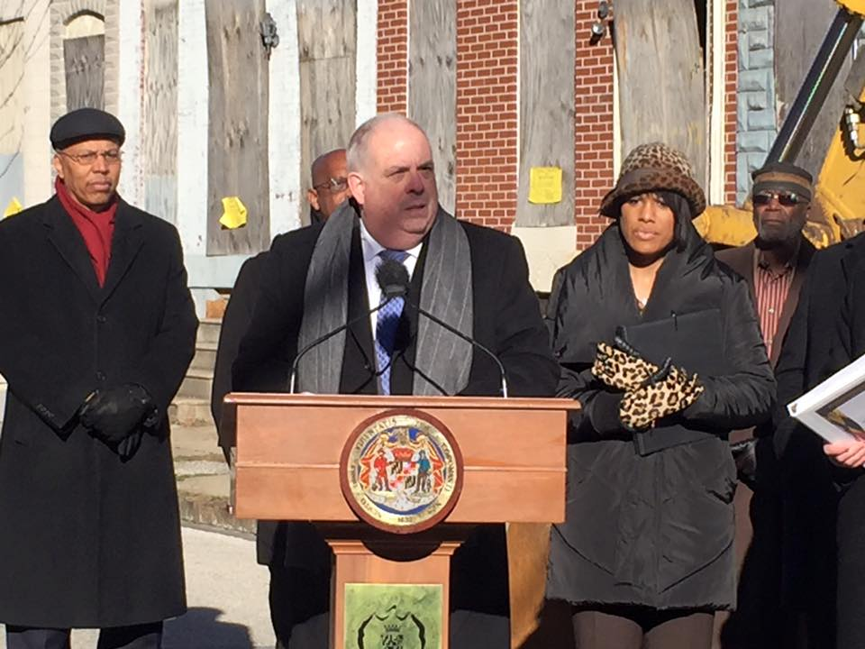 Gov. Larry Hogan announces plan to take down vacant homes with Mayor Stephanie Rawlings-Blake beside him.