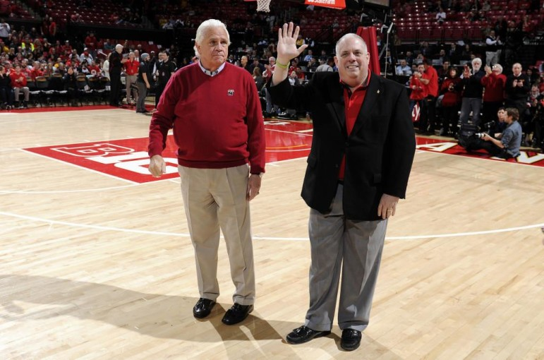 Gov. Larry Hogan waves to crowd from center court of the Xfinity Center in College Park, with Senate President Mike Miller at his side. Photo by Greg Fiume of Maryland Athletics on Hogan's Facebook page.
