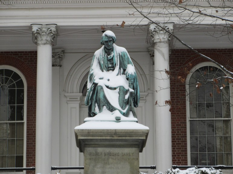 The statue of Chief Justic Roger Brooke Taney in front of the State House.